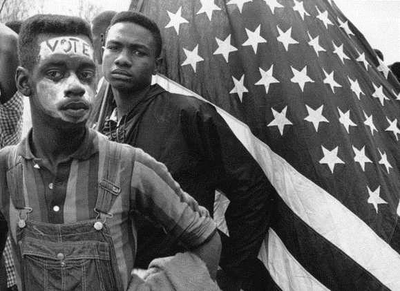 Young people demonstrating in favor of the Voting Rights Act of 1965.