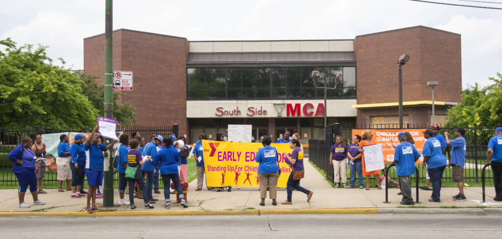 Members and allies gathered in front of the South Side YMCA