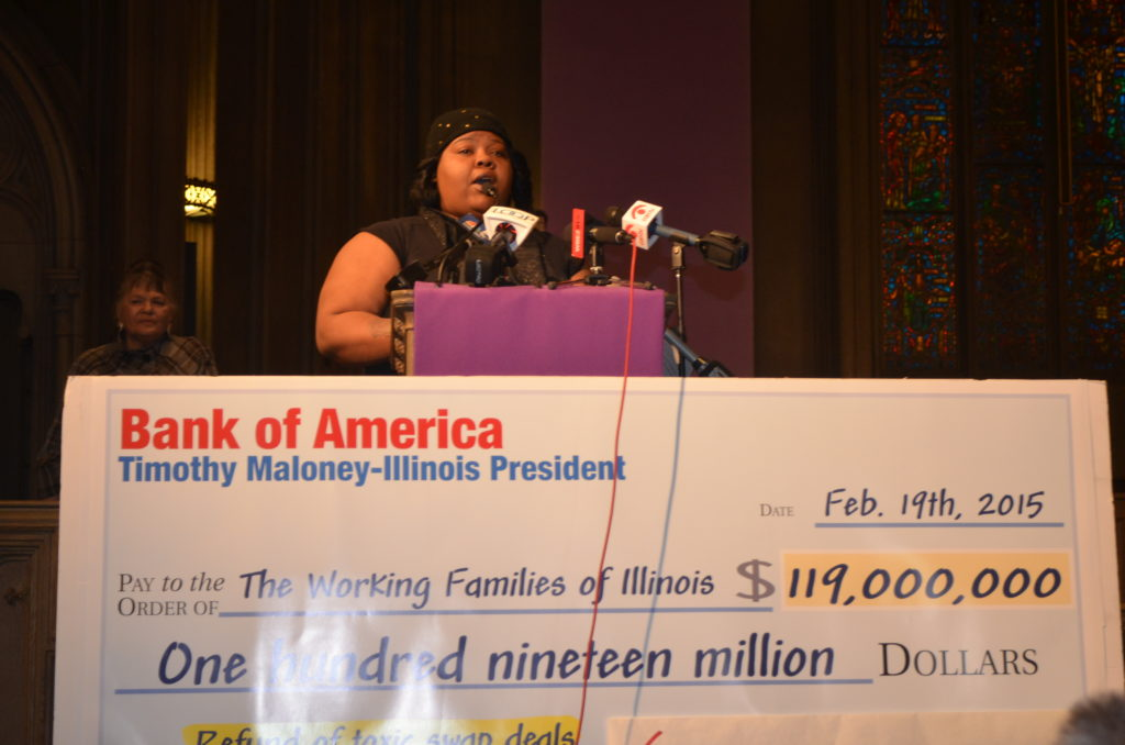 Lakeisha Collins, a nursing home worker and SEIU HCII millienal who also uses child care assistance in order to work, emceed Grassroots Illinois Action's rally at the Chicago Temple; 02/19/15.