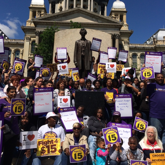 Home care workers and child care providers rally at Lincoln Statue at State Capitol to protest Gov. Rauner's actions to strip away union protections.