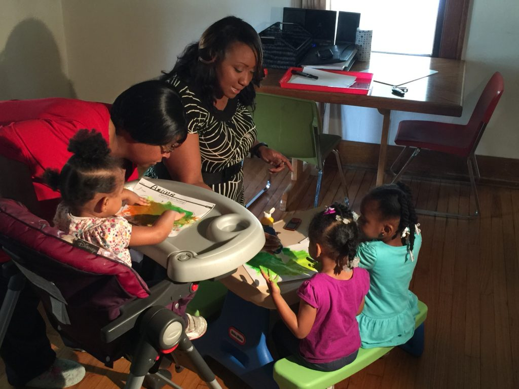 State Rep. Litesa Wallace from Rockford spends time with child care provider and young children. Rep. Wallace is an outspoken opponent of Gov. Rauner's rule changes to deny parents access to affordable child care.