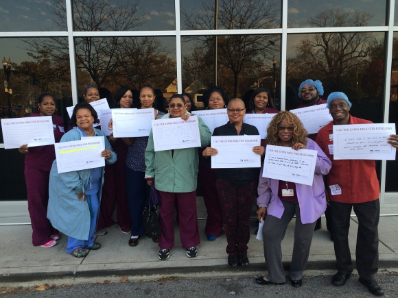 "Roseland Hospital workers rally on Nov. 10th, 2015 holding signs that say ""I go the extra mile for Roseland"" to demonstrate that workers provide quality patient care."
