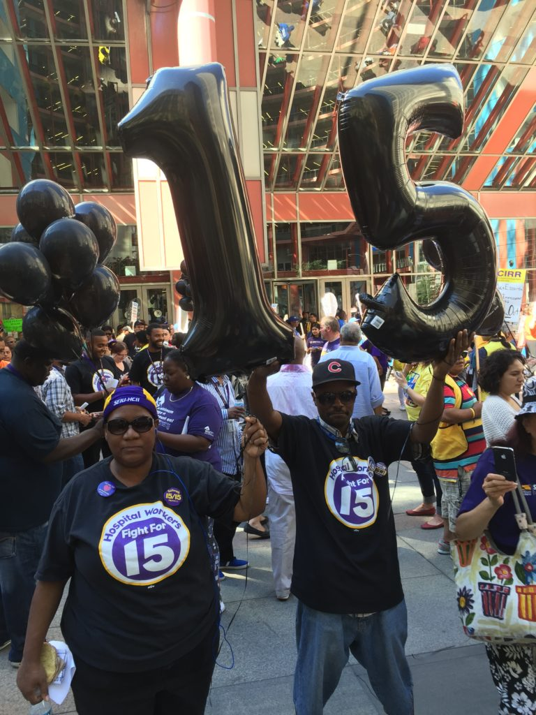 Left: Alice Jones, an ER unit secretary at Mt. Sinai, joined the Moral Monday National Day of Action at the Thompson Center in downtown Chicago on Sept. 12, 2016.