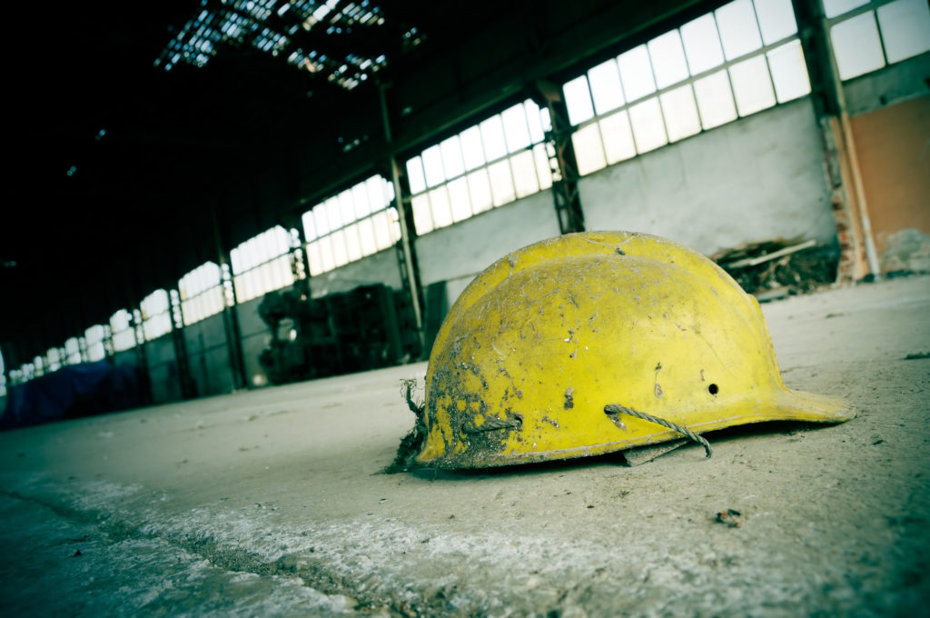 Once upon a time there were people working in this abandoned plant. Focus is on helmet.
