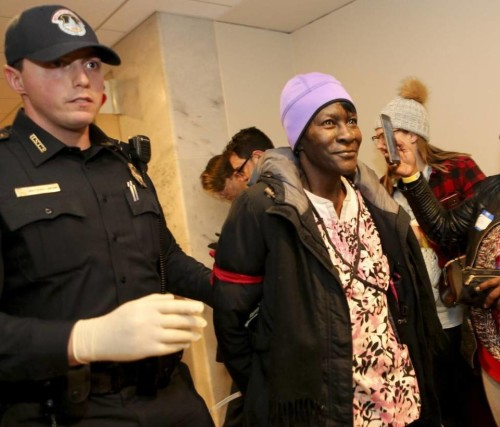 Alice Allen of Missouri, 67, who is semi-retired, is arrested in the Hart Senate Building during a protest against the repeal of the Affordable Care Act in Washington, D.C., on Tuesday, Jan. 31, 2017. A group made up of health care workers, people with pre-existing conditions and faith leaders let themselves be arrested on Capitol Hill to register dissent to Republicans' plans to repeal the Affordable Care Act, also known as Obamacare. About 50 people from 20 states were arrested for breaking the law against protesting in a Senate office building. Aude Guerrucci McClatchy