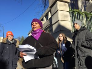 "December 6th, 2017: Kim Smith, a Patient Care Tech at Northwestern Memorial Hospital and member of HCII's executive board, speaks outside of Loyola University in Chicago about the Republican ""tax scam"" and calls out Gov. Bruce Rauner to oppose the bill."