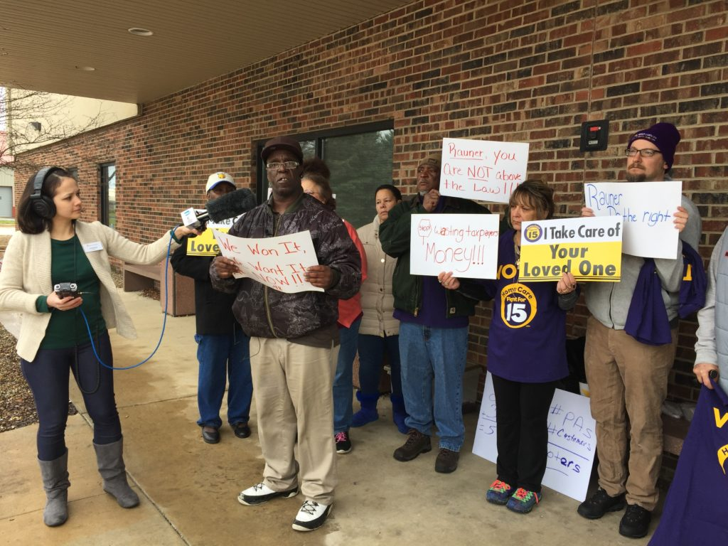 Ginger Grant and Richard Osby led a press conference in Champaign, surrounded by fellow caregivers impacted by the governor's appeal.