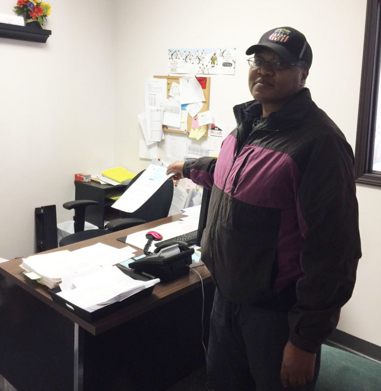 HAH member Katrina Sturvant leaves a letter on her supervisor's desk demanding answers.
