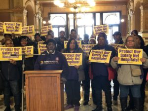 Joan Rodriguez, a housekeeper at Mt. Sinai Hospital, speaks at a press conference in the State Capitol about protecting safety net hospitals; Nov. 13th, 2018
