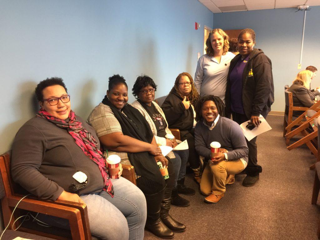 From left: Holy Cross Patient Care Techs Phyllis Johnson; Meco Clark; and Shirley Jenkins; Venson Curington (organizer); Bonita Williams (St. Bernard); Sandra Summage (Metro South, standing); Anne Igoe, VP of HCII Health Systems; Dec. 5th, 2018.