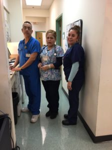 (Photo caption: far right, Irma Contreras, a Medical Assistant, speaks out about unfair wage caps at Alivio).