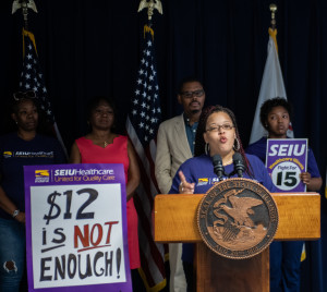 Iashea Cross, a personal assistant and home care worker in the DHS Home Services Program says voters must take our fight for $15 to the ballot box).