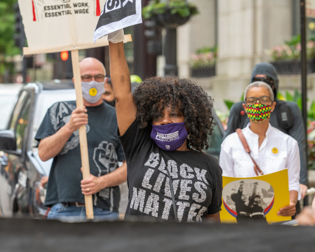 Jaquie BLM shirt fist up and mask Juneteenth Rallyh