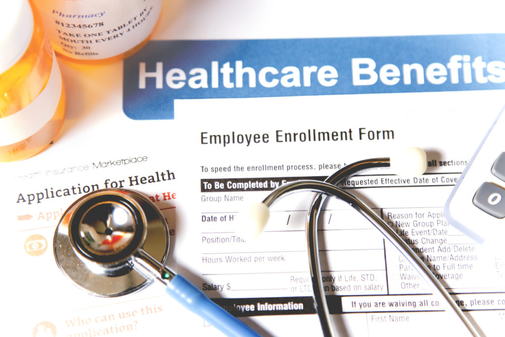 Open enrollment healthcare benefit forms.